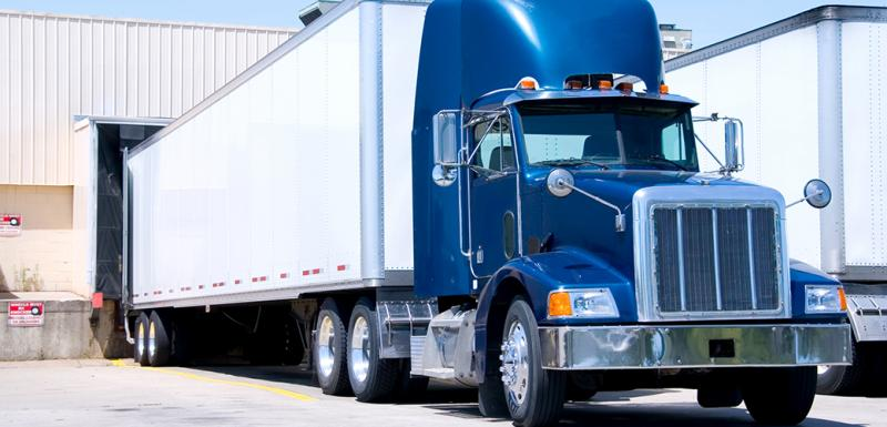 white and blue semi truck